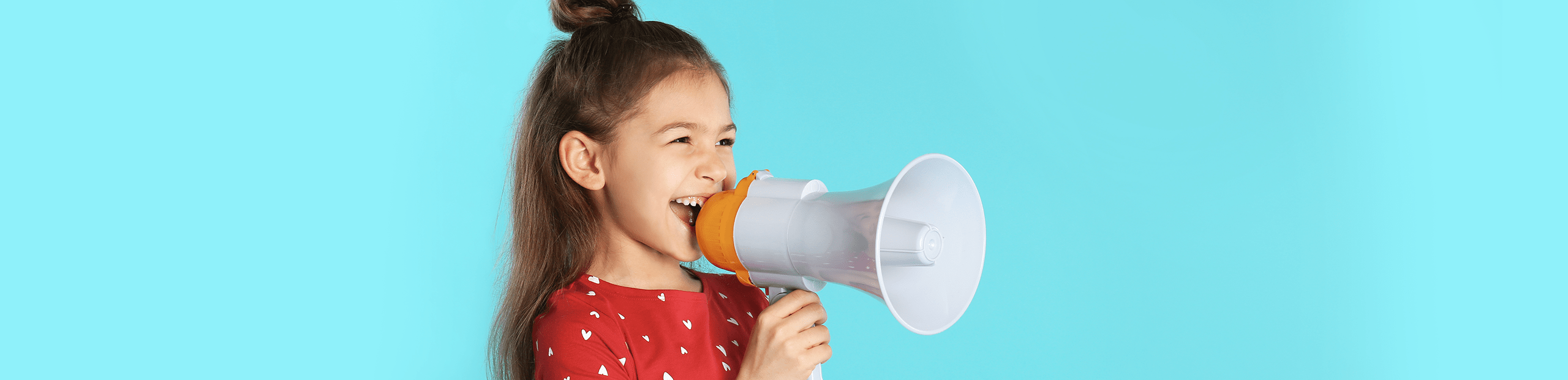 young girl laughing holding a megaphone
