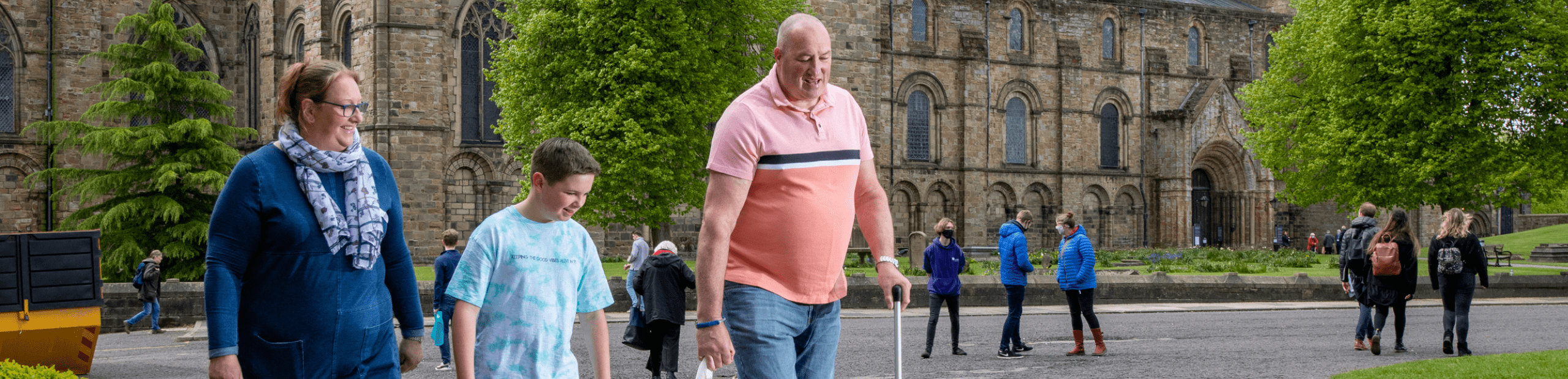 Family walking past Durham Cathedral
