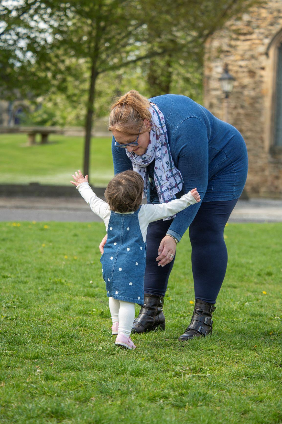 Little girl running towards mam